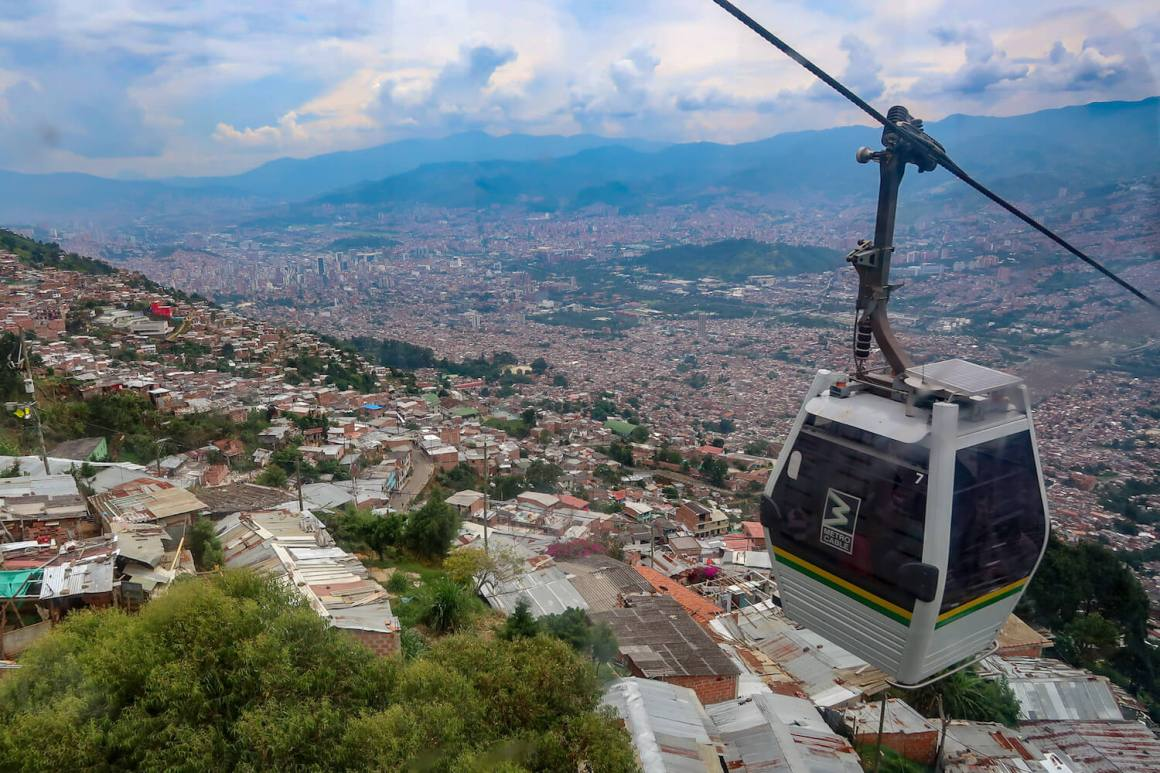 The Metrocable, a top Medellin attraction, with the city in the background