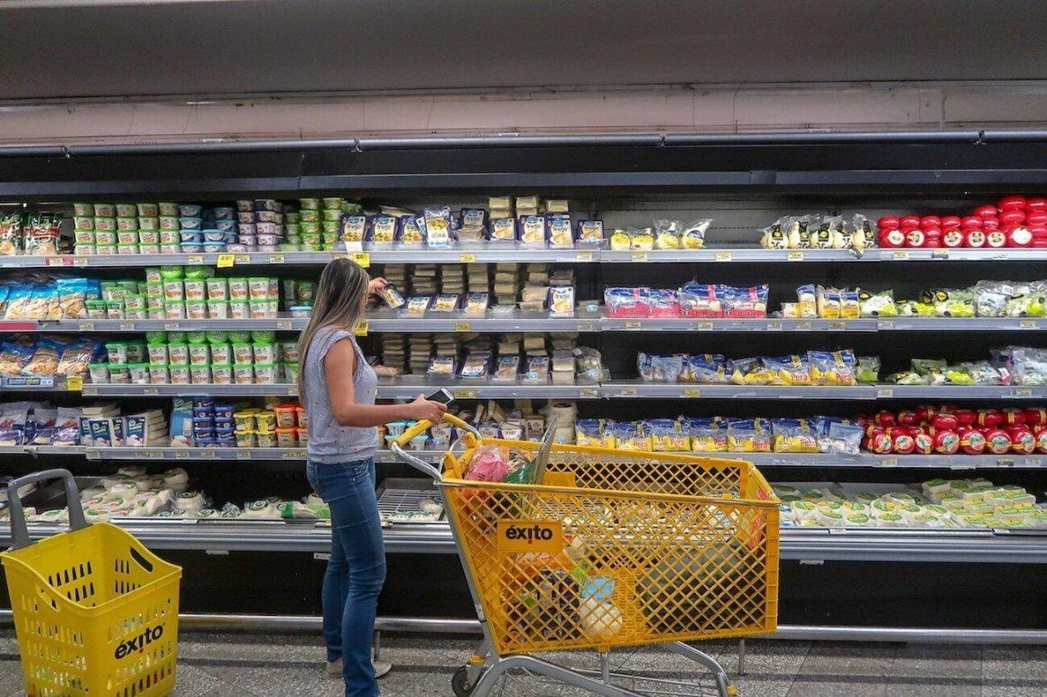 Shopper in supermarket aisle in Exito Patio Bonito
