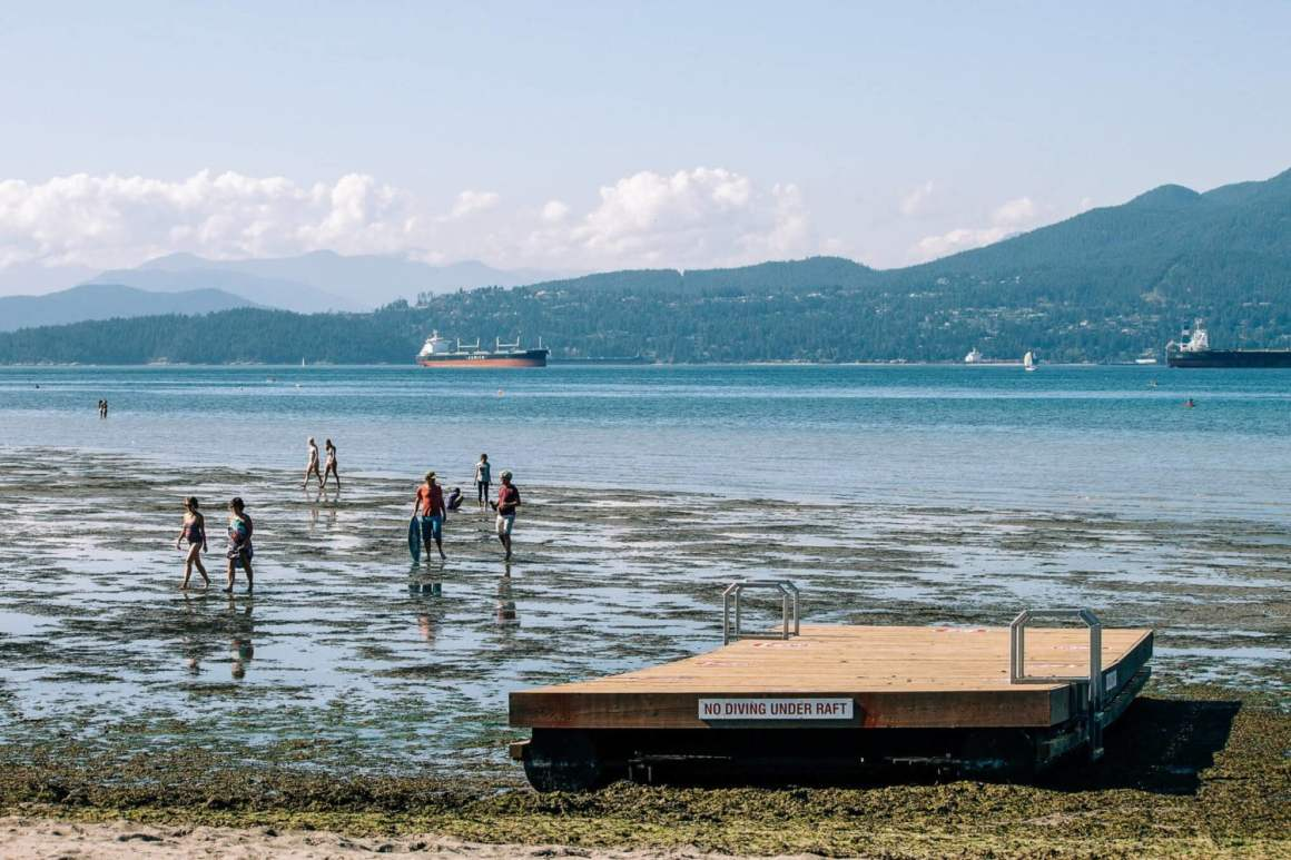 locarno beach dock with the tide way out in vancouver