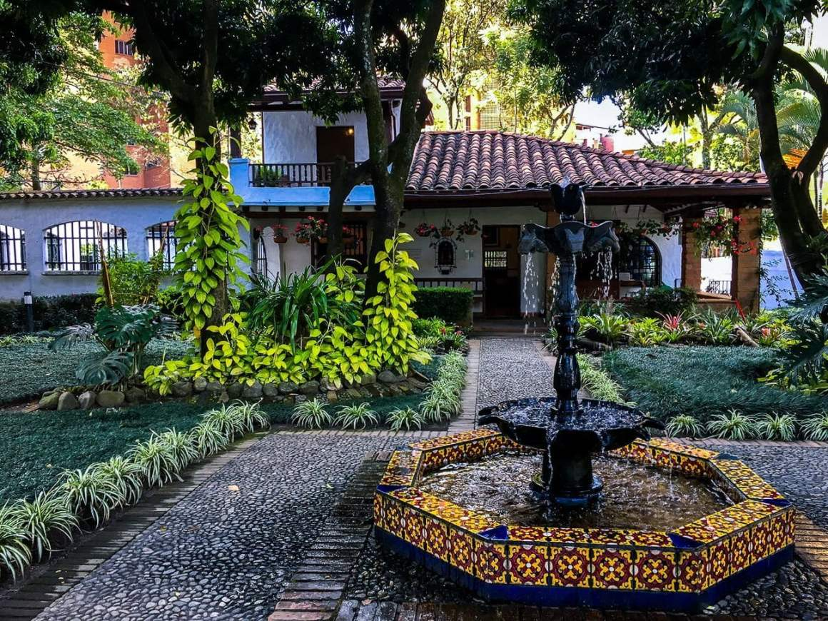 serene waterfall entrance to cafe otra parte in envigado