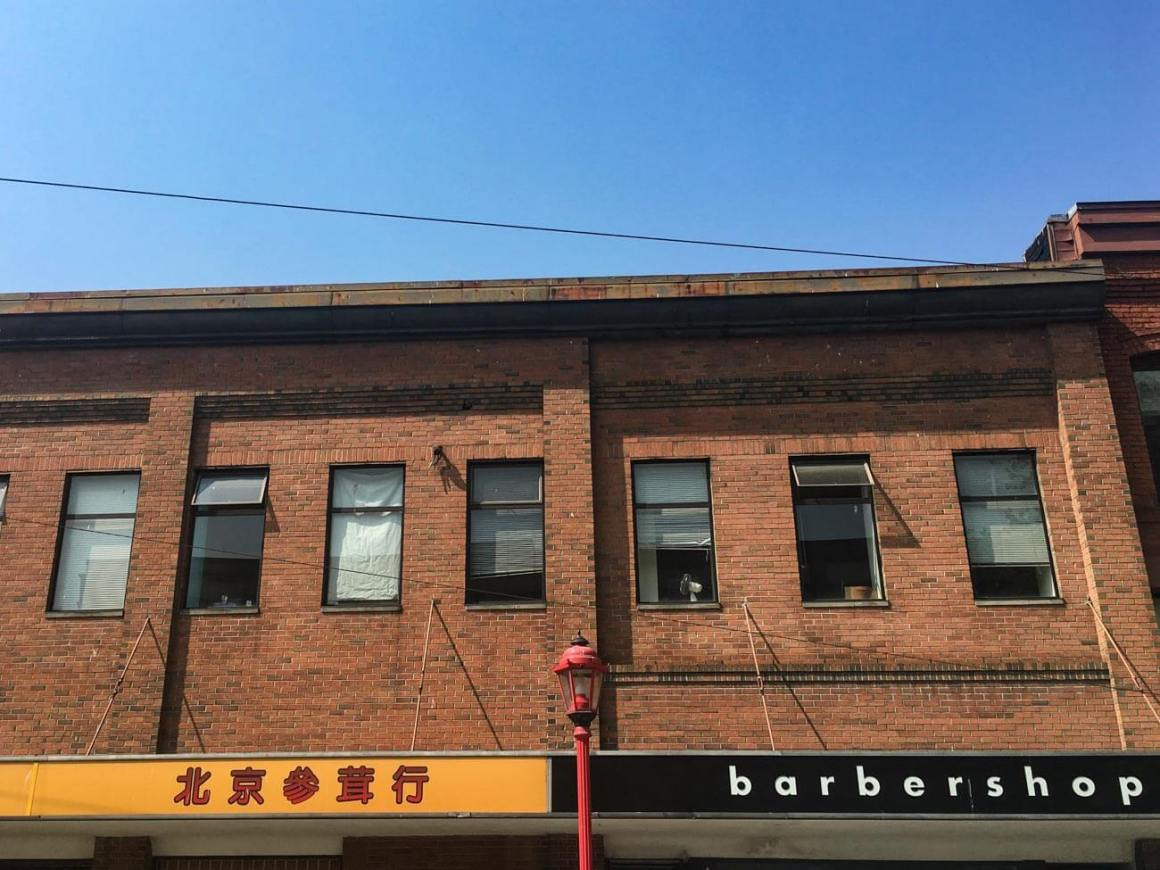 Chinese storefront beside barbershop