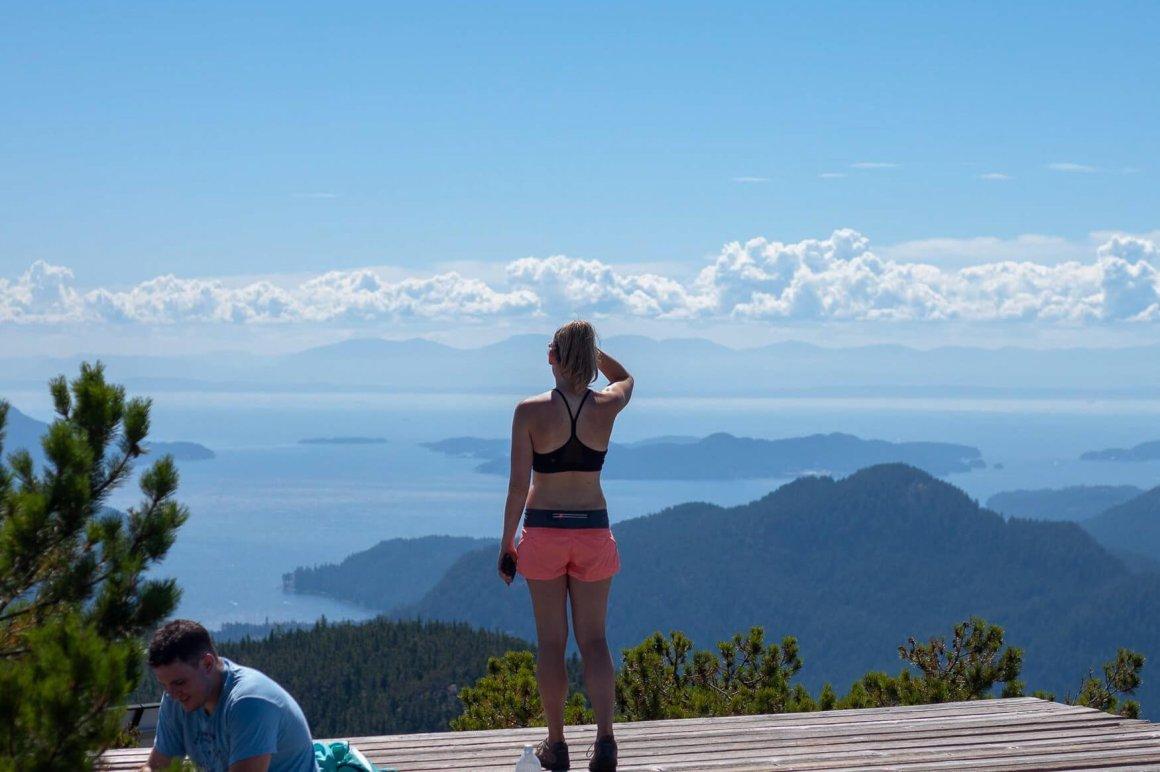 kelly standing on heli pad on top of anvil island
