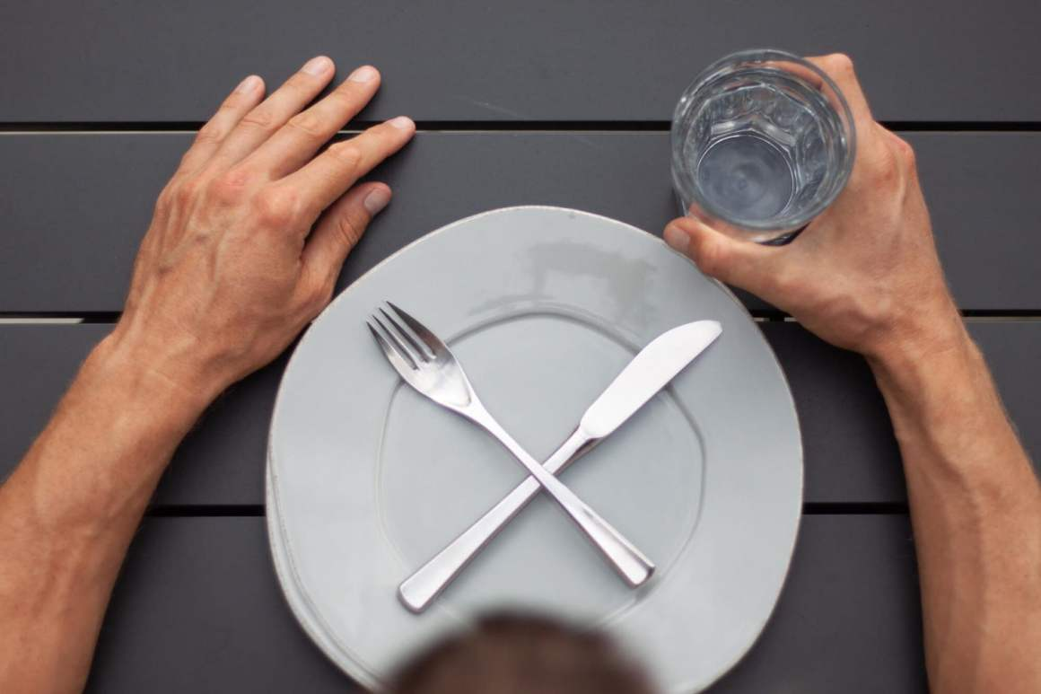 water fasting tips cover image of an empty plate and glass of water