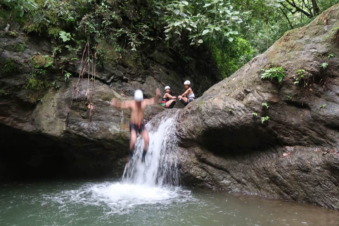 Chris' dad jumping off waterfall in Costa Rica, hopefully covered by travel insurance