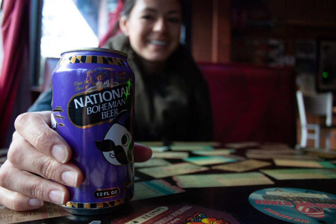 Kim holding a Natty Bo beer in D.C.