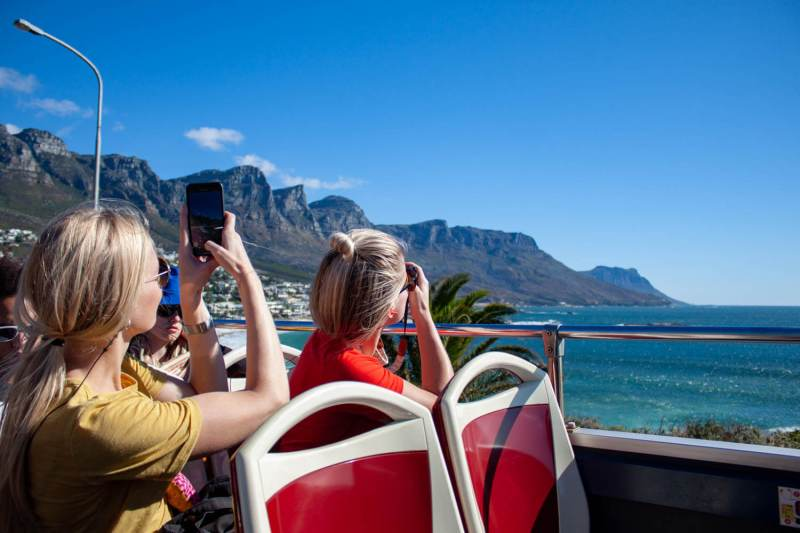 Cape Town hop-on hop-off cover image of people taking photos from upper deck of bus
