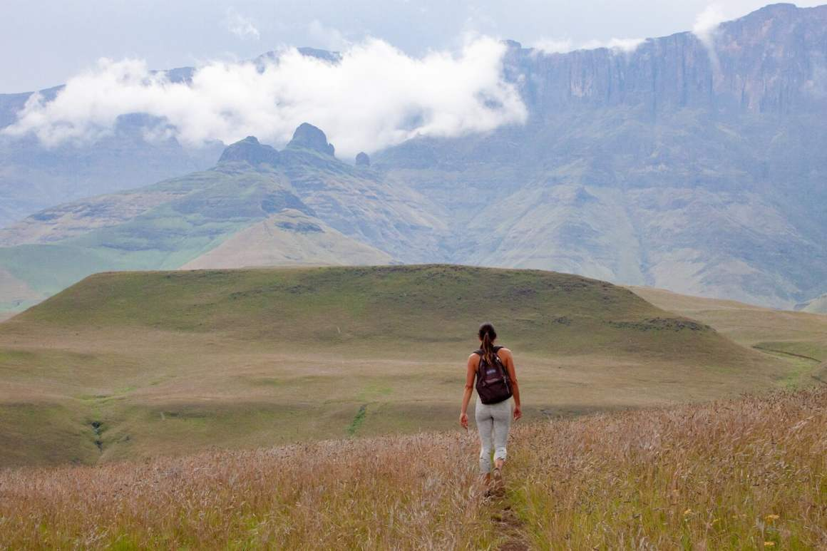Kim hiking in Cathedral Peak on Day 3 of our South Africa road trip
