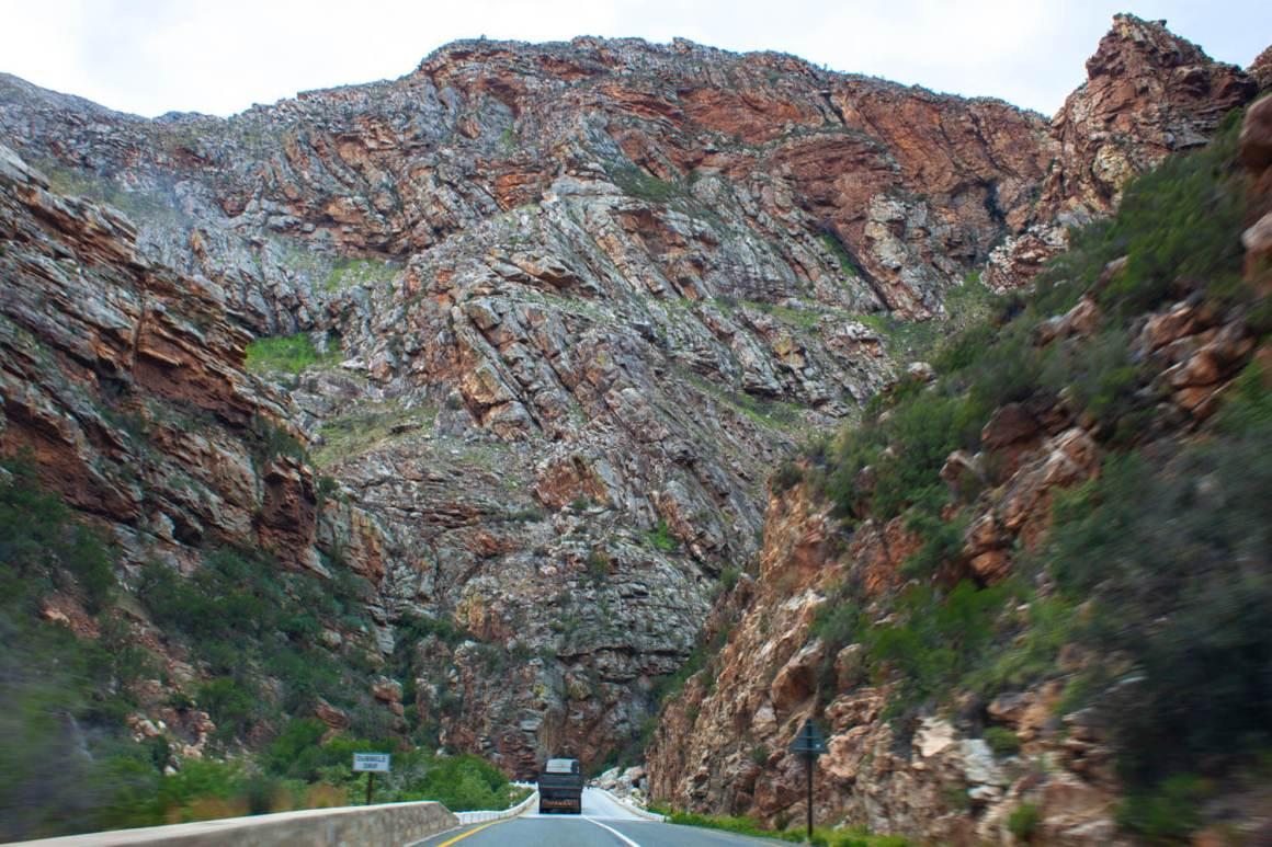 Big truck, bigger rock wall in Meiringspoort Pass