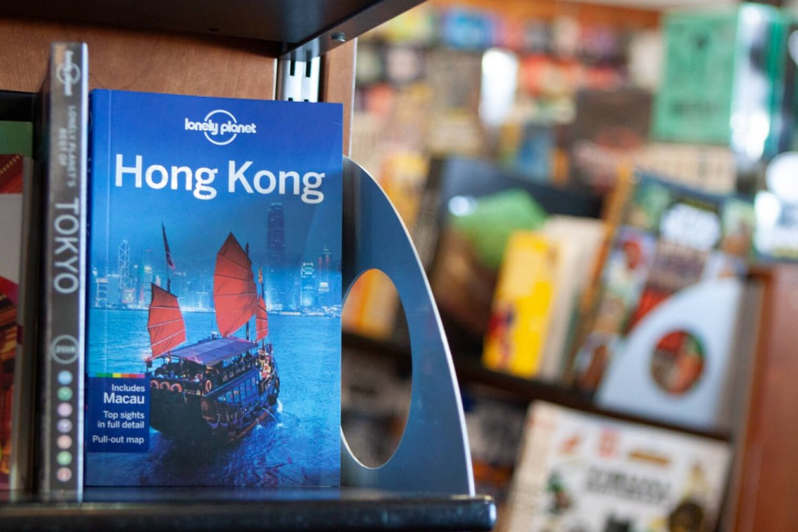 A Lonely Planet Hong Kong guide on a bookstore shelf.