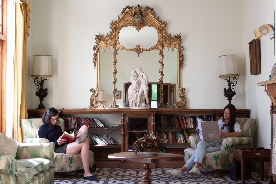Rebecca and Kim read books inside the lord milner hotel at our pitstop in Matjiesfontein, along Route 62.