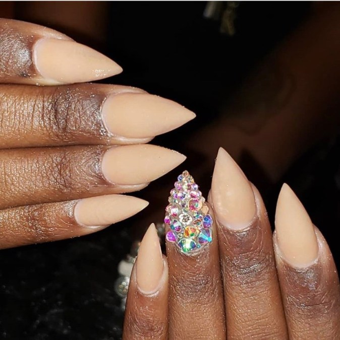 Nude acrylic short stiletto nails with gemstone accents
