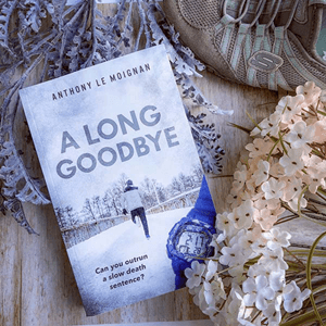 Novel About Alzheimer's disease A Long Goodbye Anthony Le Moignan bookstagram with blue running shoes and pink and white flowers