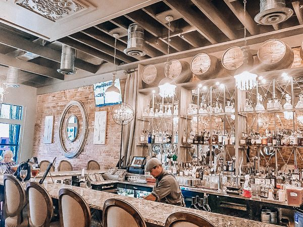 Inside of The Ivy in Ocala, Florida, speakeasy bar with bartender wearing suspenders