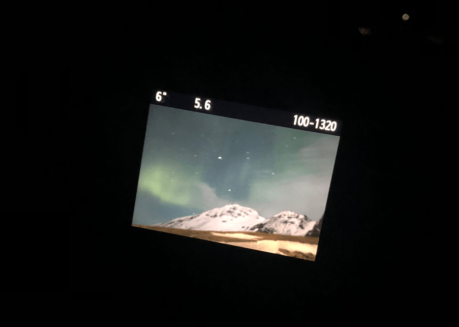 Visiting Iceland in the winter with Northern Lights on a camera viewfinder in Iceland
