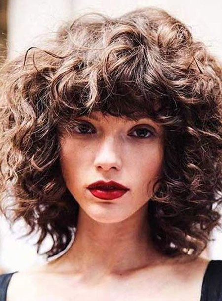 Curly-Hair-with-Bangs-and-Layers Popular Short Curly Hairstyles 2018 – 2019