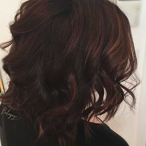 Curled-Dark-Hair Alluring Short Curly Hair Ideas for Summertime