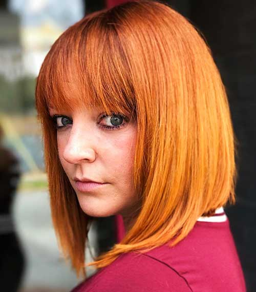 Redhead-with-Green-Eyes Eye-Catching Short Red Hair Ideas to Try