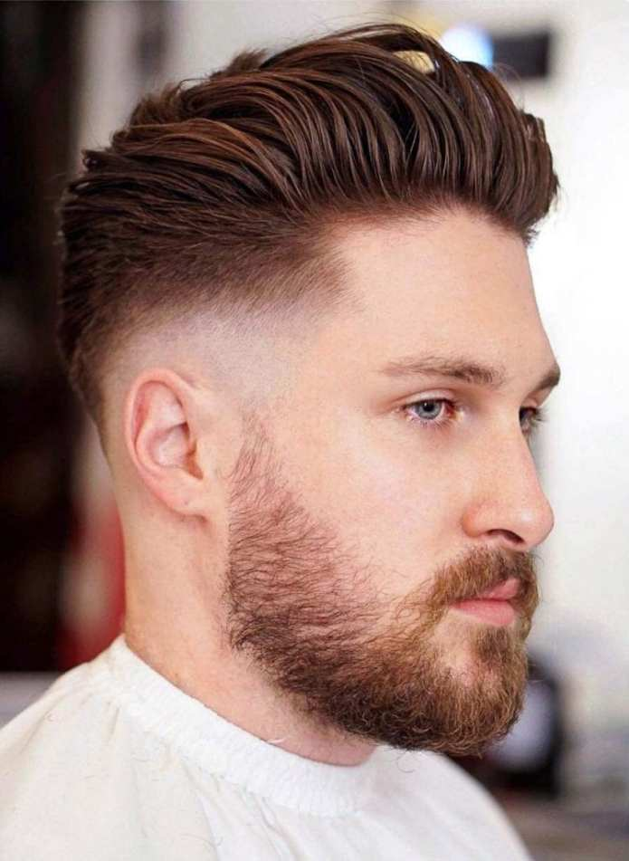 Slicked-back-mid-skin-fade Stylish Undercut Hairstyle Variations For 2019