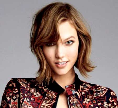 Wavy-Hair-with-Side-Swept-Wavy-Bangs-in-Front Short Wavy Hairstyles 2019