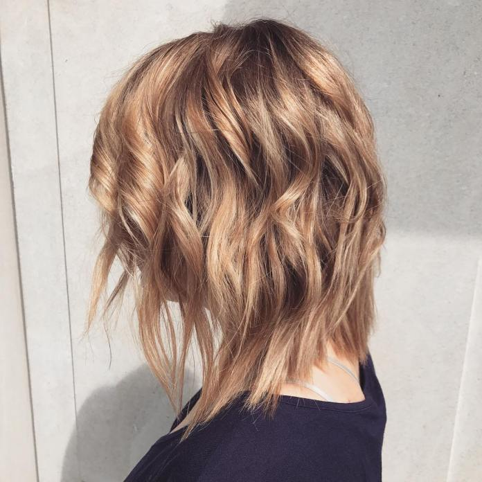 Chopped-and-Curled-Asymmetric-Bob Simple Medium Hairstyles for Stunning Look