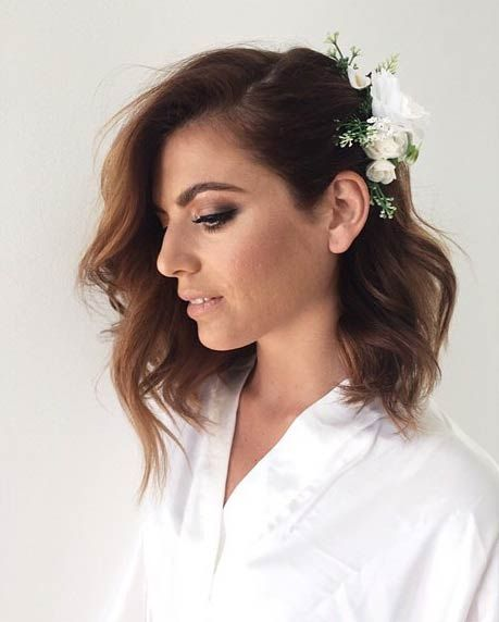 Mid-length-Hair-with-Flower-Clip Wedding Hair Ideas for Spring