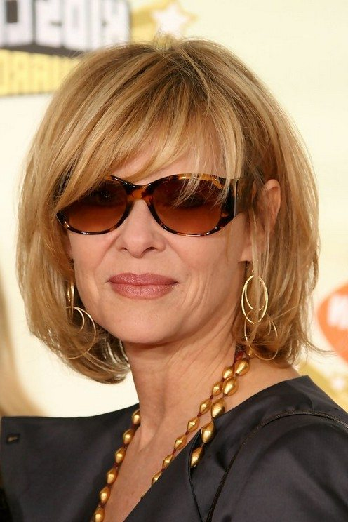 Short-Blonde-Hair-With-A-Textured-Fringe Hairstyles for Women Over 50 With Glasses