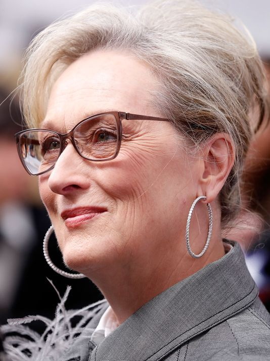 Short-layered-Haircut-with-Bangs-Curved-Across-the-Forehead Hairstyles for Women Over 50 With Glasses