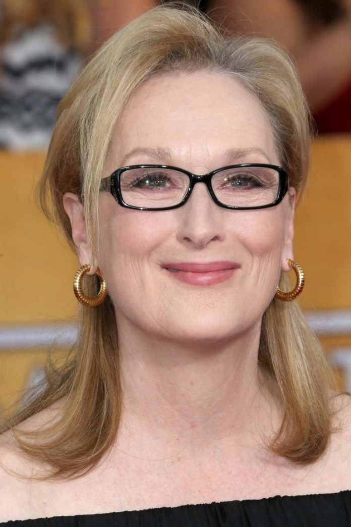 Sleek-Shoulder-Length-Hairstyle Hairstyles for Women Over 50 With Glasses