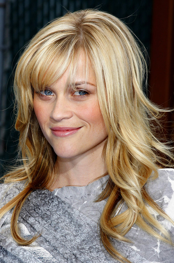 Blow-Dried-Edges-And-Small-Bangs Layered Hairstyles With Bangs