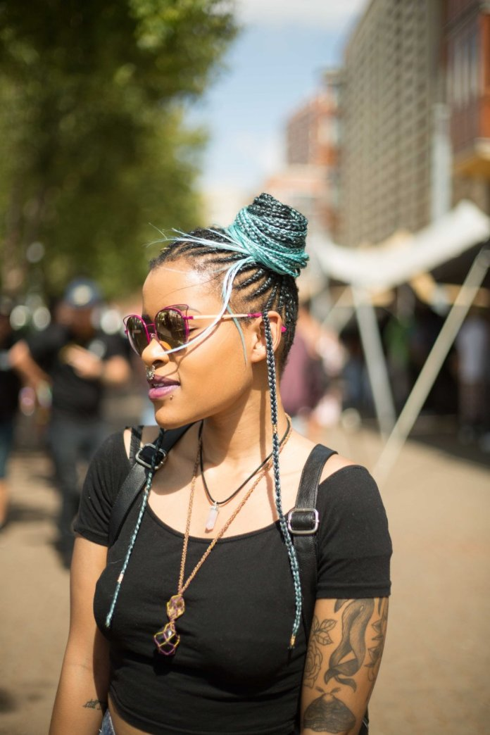 Cornrow-Side-Top-Bun Most Stylish Afro Hairstyles for Women to Look Stunning