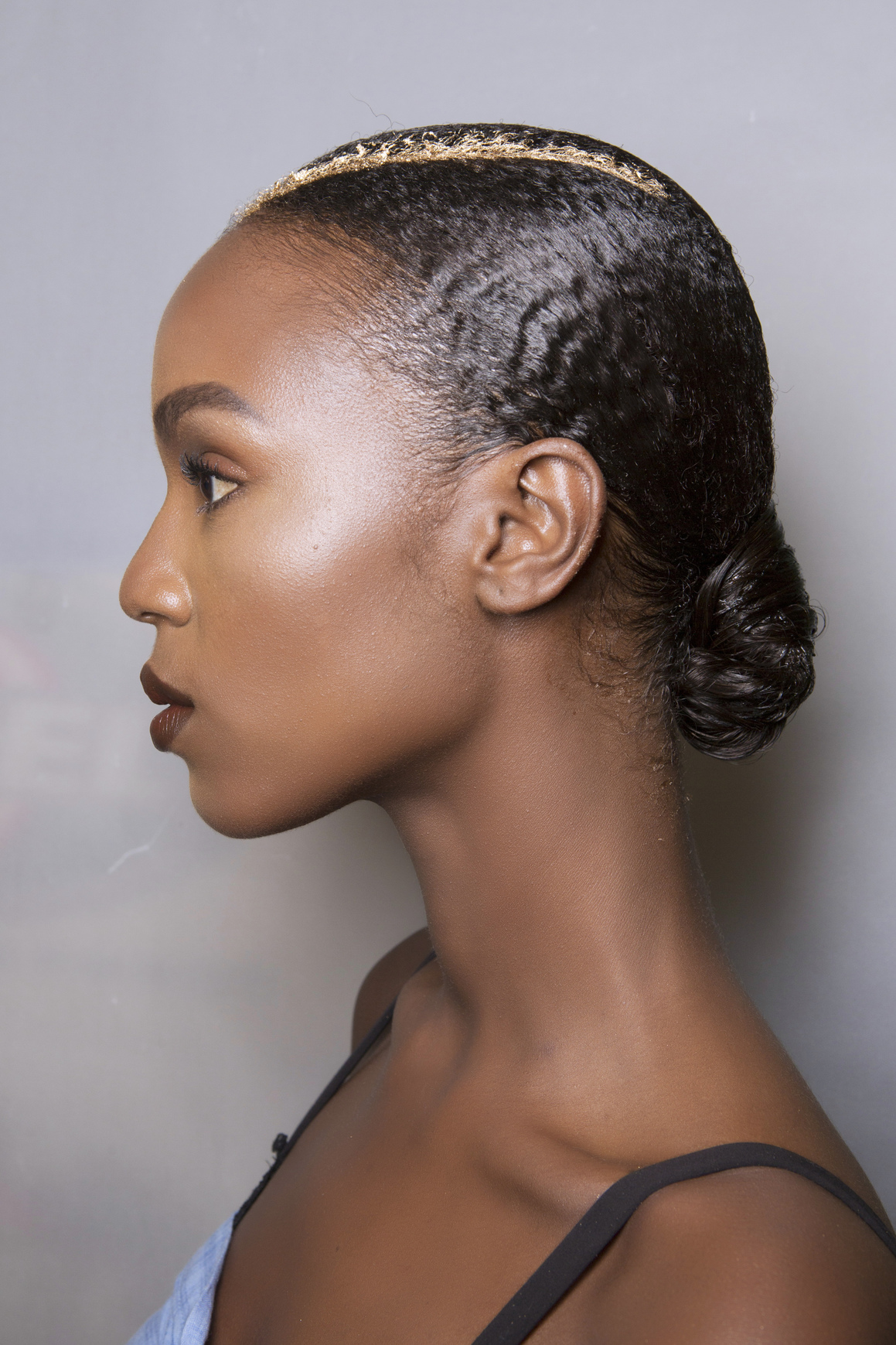 Low-Bun-Afro-Hairstyle Most Beautiful Natural Hairstyles for Wedding