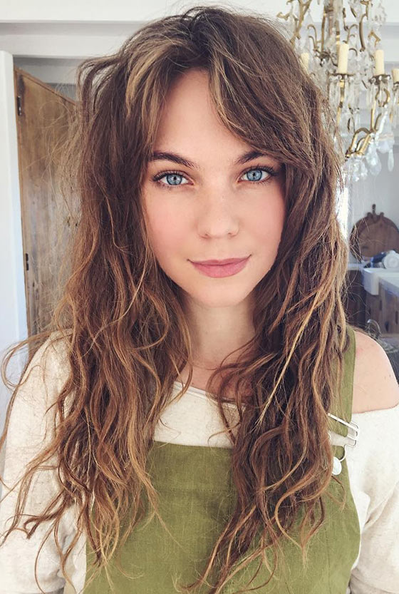 Messed-Up-Waves-And-Split-Up-Bangs Layered Hairstyles With Bangs