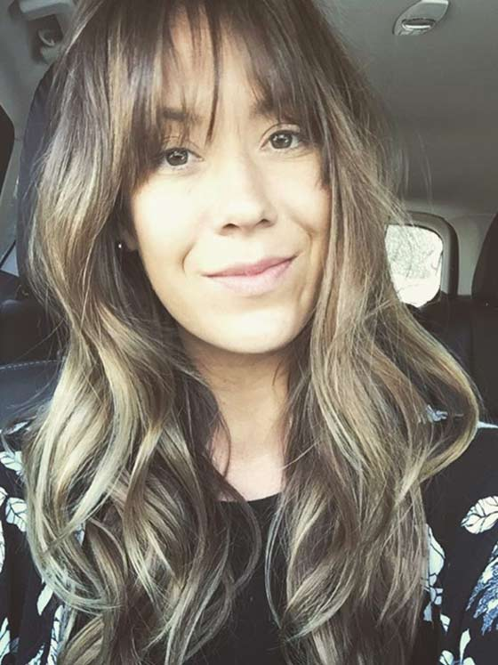 Relaxed-Curls-With-Wispy-Bangs Layered Hairstyles With Bangs