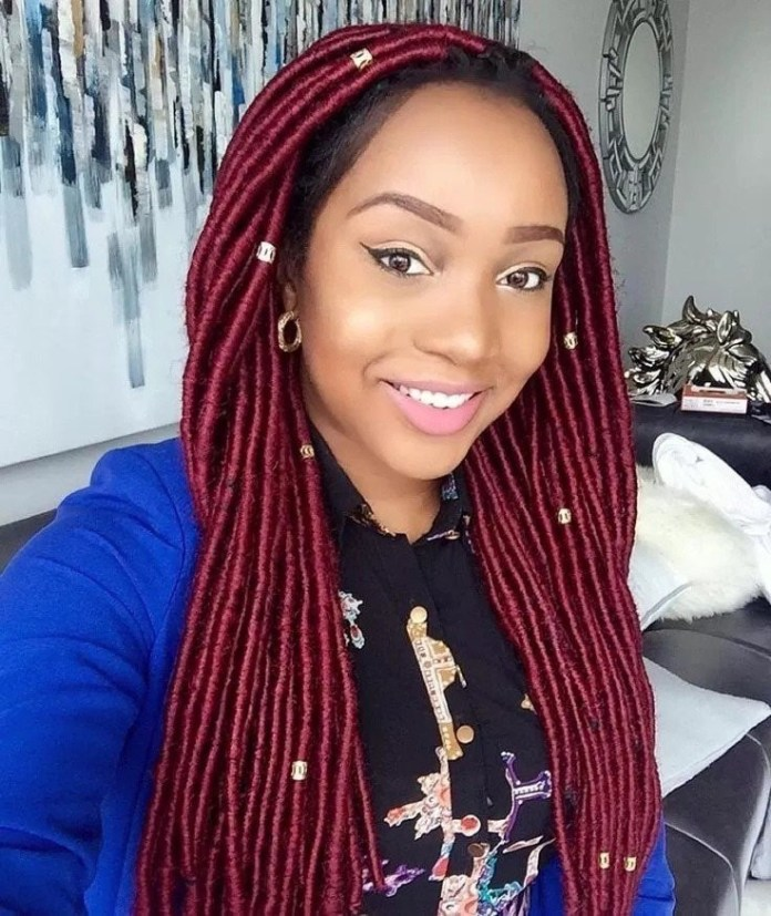 Roped-Strands-Tied-with-Metallic-Red-Thread-and-Accessorized-with-Metallic-Beads Most Stylish Prom Hairstyles for Black Girls