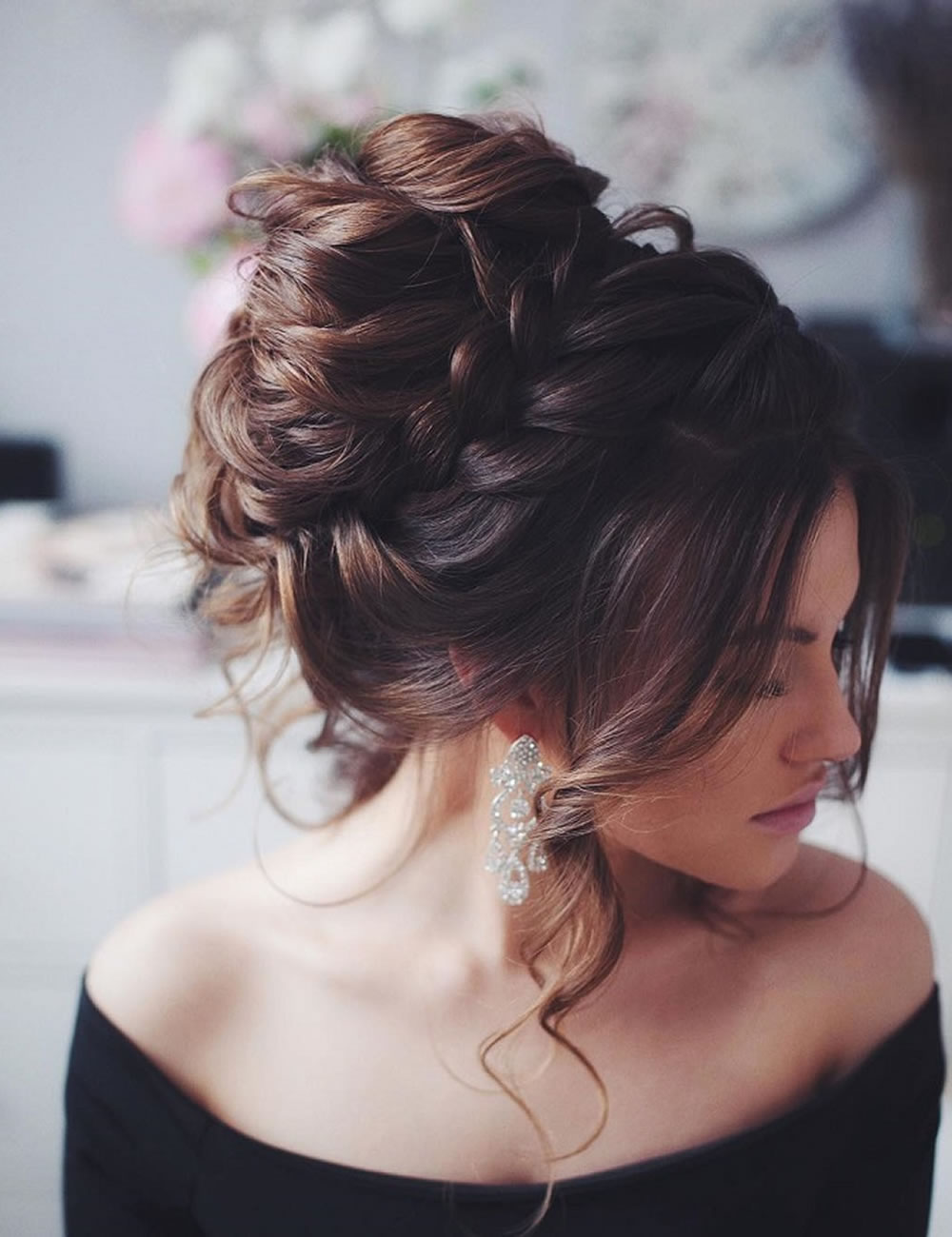A-Huge-High-Bun-That-Defies-Gravity Christmas Party Hairstyles to Enhance Your Look