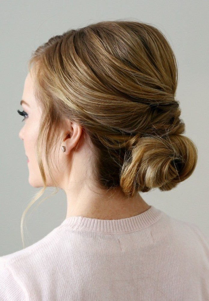 A-Sweet-and-Subtle-Twisted-Low-Bun Christmas Party Hairstyles to Enhance Your Look