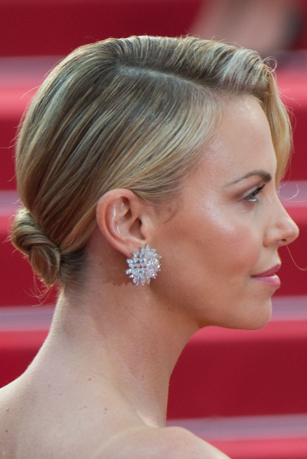An-Elegant-Neatly-Combed-Low-Bun-with-Side-Fringes Christmas Party Hairstyles to Enhance Your Look