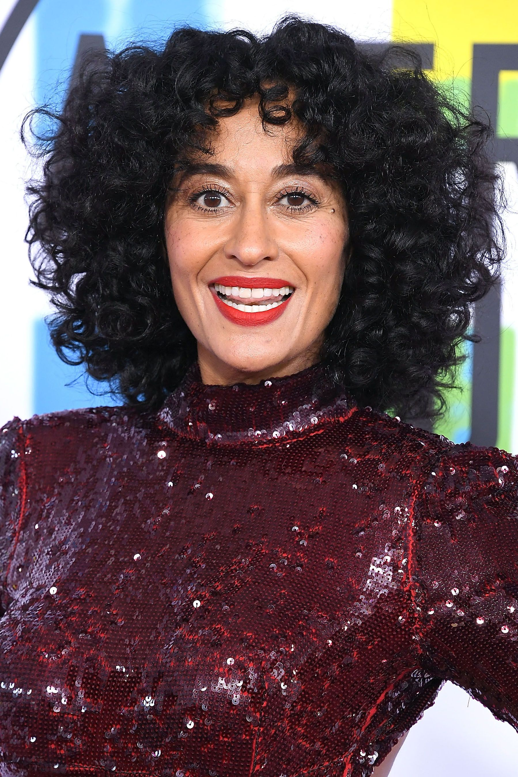 Curly-Twirls-with-Long-Front-Fringes Charming and Cute Hairstyles for Black Women