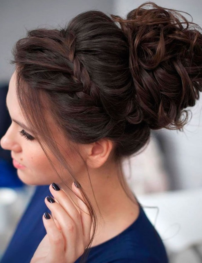 French-Braided-Puffed-Bun-with-Curly-Thin-Hair-Strands Christmas Party Hairstyles to Enhance Your Look