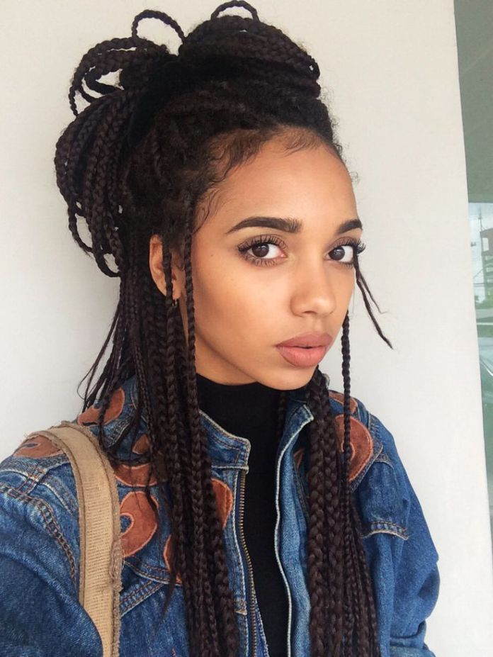 High-Bun-and-Flowing-Braided-Strands-on-Shoulders Stylish and Stunning African American Braids