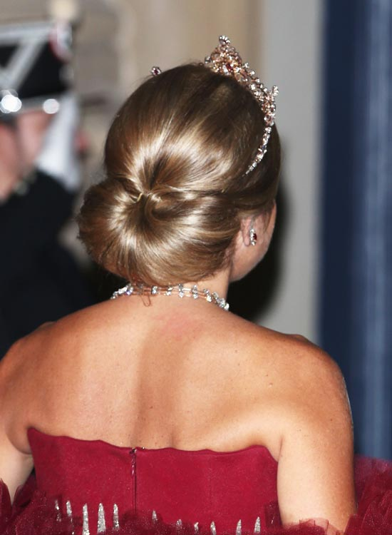 Low-Semi-Circular-Bun-With-Pouf Bridal Hairstyle Ideas For Your Reception