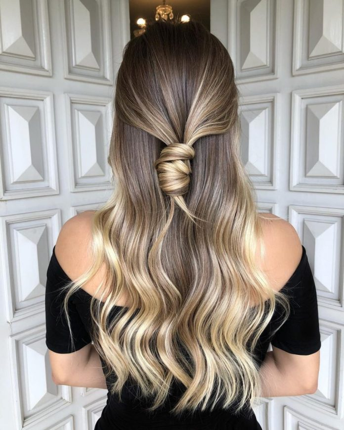 Middle-sized-hair-with-a-knot-at-the-back Most Attractive Fall Hairstyles to Try This Year