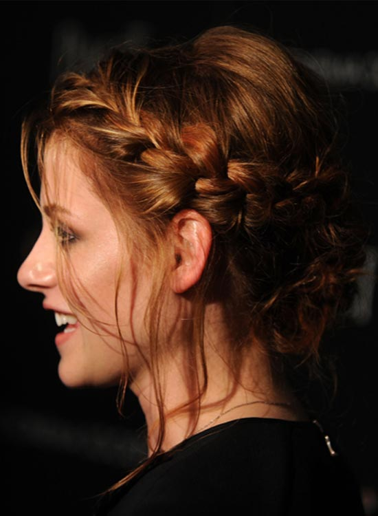 Puffy-Low-Hairdo-With-Braided-Wraparound Bridal Hairstyle Ideas For Your Reception