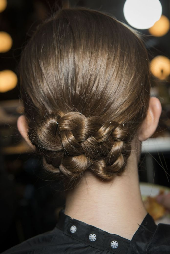 Silky-and-Glossy-Braided-Bun Christmas Party Hairstyles to Enhance Your Look
