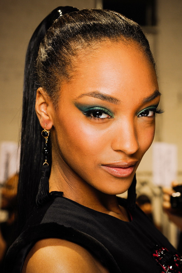 Tight-Ponytail-at-the-Top-of-the-Back Charming and Cute Hairstyles for Black Women