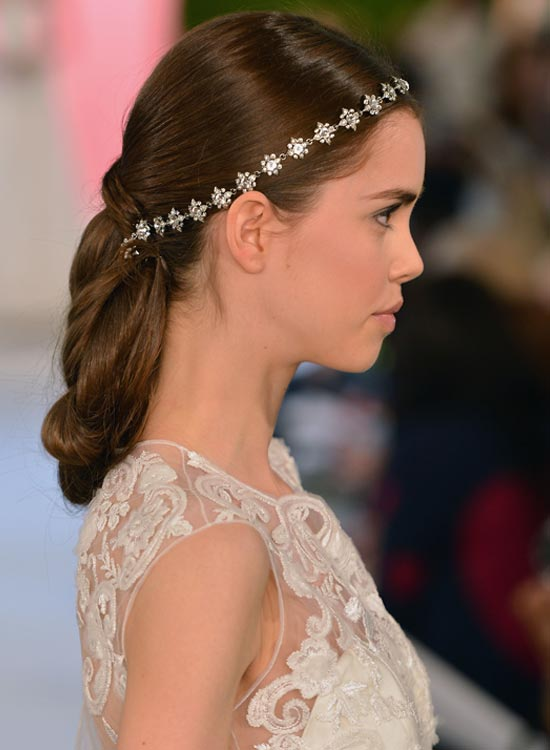 Twisted-and-Folded-Low-Hairdo Bridal Hairstyle Ideas For Your Reception