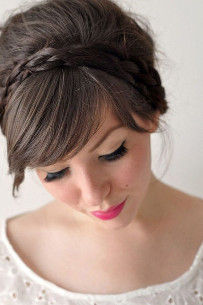 Ash-Brown-Side-Curved-Bangs-with-Bun-and-Braided-Headband Most Beautiful Wedding Hairstyles with Bangs