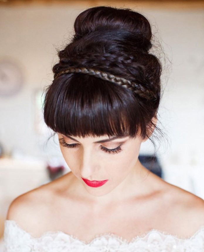 Barbie-Like-Bangs-with-a-High-Bun-and-Braided-Band Most Beautiful Wedding Hairstyles with Bangs