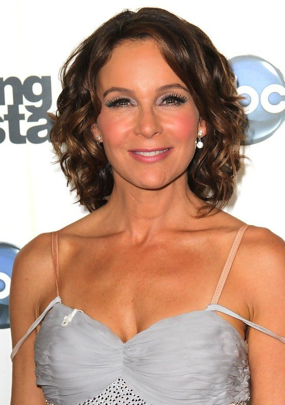 Center-Parted-Medium-Wavy-Hairstyle Medium Hairstyles for Women Over 50
