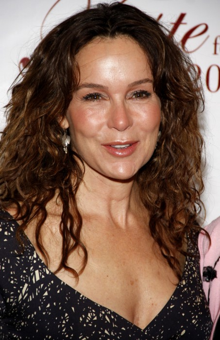 Center-Parted-Tight-Wavy-Long-Hair Long Hairstyles for Women Over 50 – Look Trendy And Fashionable